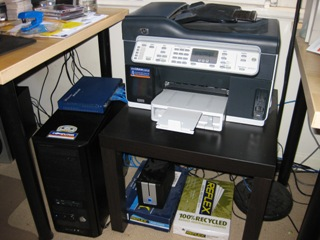 HP OfficeJet Pro L7580 printer with D-Link DNS-323 below
