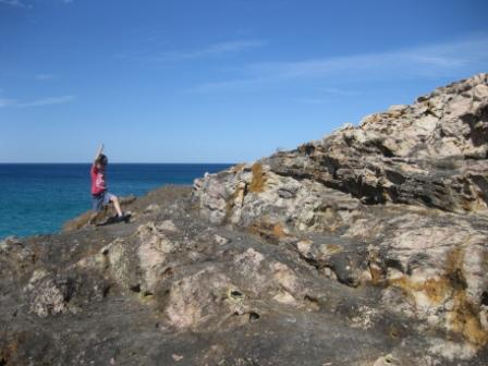 The headland offers some rock scrabbling fun for the kids