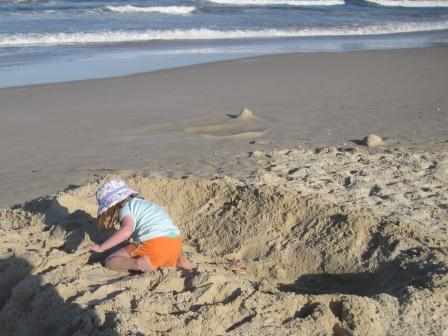 Playing in the sand on Seven Mile Beach at Lennox Head
